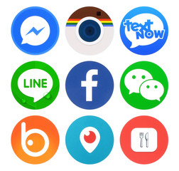 Kiev, Ukraine - April 22, 2016: Collection of popular round social networking icons, printed on paper: Facebook, Messenger, Text Now, Line, Periscope and others