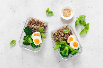 Lunch boxes with broccoli, quinoa and egg, healthy  food, balanced eating concept, top view