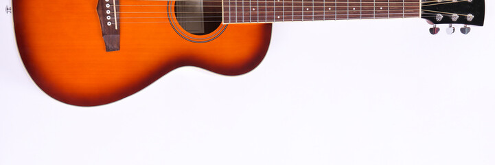 Folk style parlor acoustic guitar isolated on white background with a lot of copy space for text....