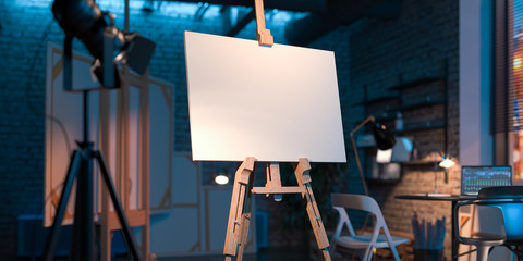 Easel With Blank Canvas Illuminated By Searchlight In Stylish Workshop. Empty Space. Copy Space. 3D rendering.