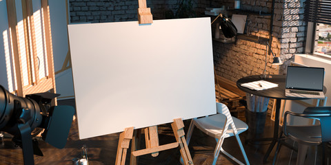 Easel With Blank Canvas Illuminated By Sun Light From Window With Modern Laptop on Background. 3D rendering.