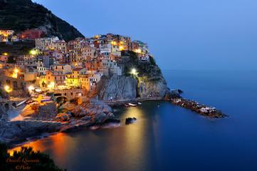 Keuken foto achterwand Liguria ILLUMINATED HOUSES BY SEA AGAINST CLEAR SKY AT NIGHT