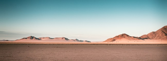 Breathtaking panoramic shot of desert plains in Namibia Africa with hills in the background