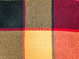 Texture of colored checkered woolen fabric.