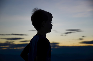 silhouette of boy at sunset