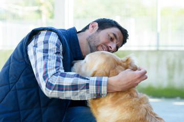 vet checking an infected dog ear
