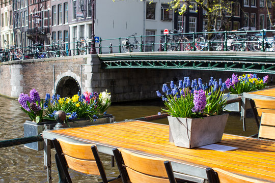 Terrace of cafeteria with a view to the famous channels of Amsterdam