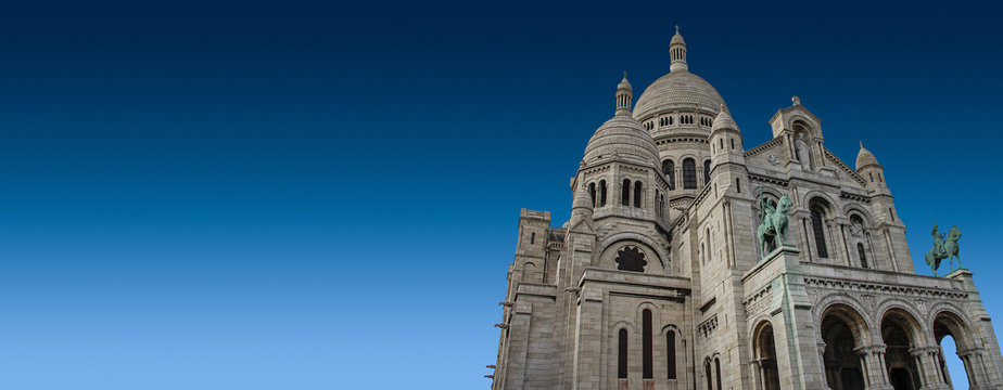Banner with Majestic Sacre-Coeur Montmartre Basilica at blue sky background and copy space, Paris, France, design, architecture