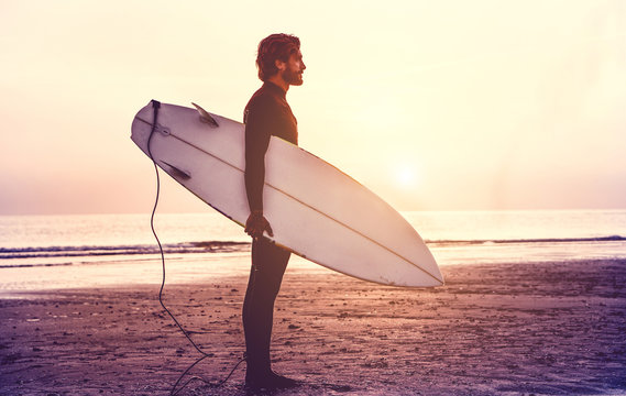 Man With Surfboard Standing At Beach