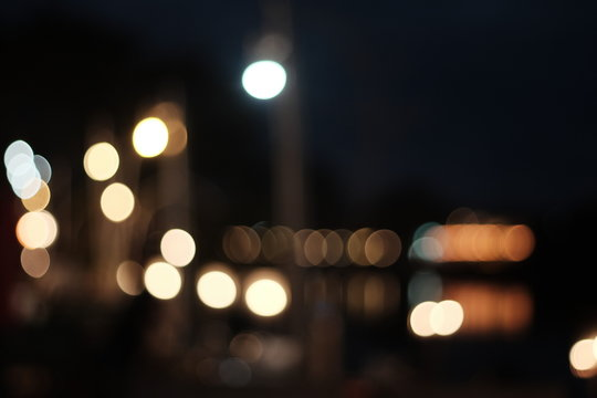 Defocused Image Of Illuminated Lighting Equipment At Night