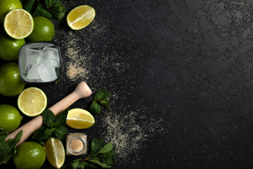 process of making homemade cocktail, flat with the ingredients for mojito on a black background, a refreshing summer cocktail