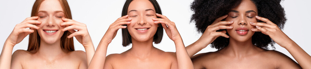 Cheerful diverse women touching face after surgery