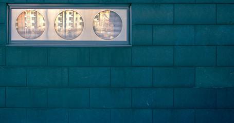Illuminated Lights On Blue Brick Wall