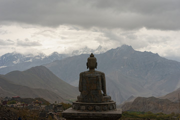 Statue Of Buddha Against Mountain Range
