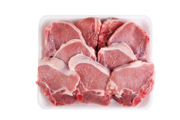 A tray full of fresh Pork Loin Chops isolated on white.