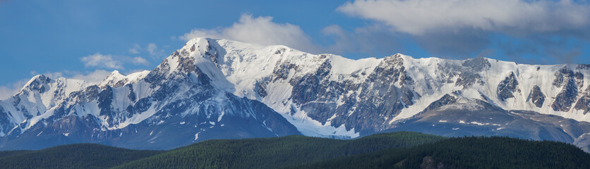 Wall Mural - Snow-covered mountain range, panorama nature, Altai. Travel and vacation in the mountains.