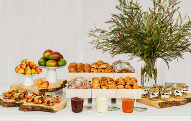 Breakfast buffet with pastries, yogurt, and fruit