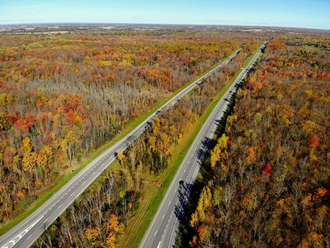 The aerial view of the traffic and stunning fall foliage near Watertown, New York, U.S.A