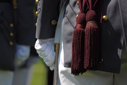 Midsection Of Man In Uniform Standing Outdoors
