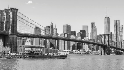 Low Angle View Of Brooklyn Bridge Over East River With Buildings In Background