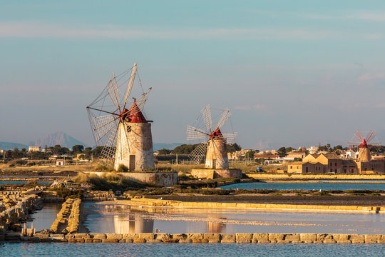 Italy, Sicily, Trapani Province, Marsala. Wind mills at the salt evaporation ponds in the Stagnone Nature Reserve, in Marsala.