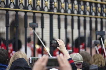 Selective focus of people gathered in front of the historic Buckingham Palace