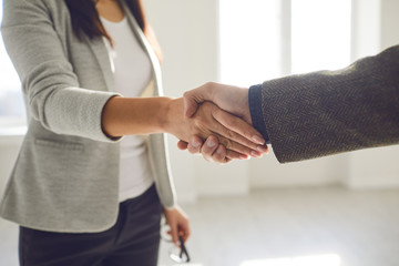 Handshake of businesspeople. Female and male hand makes a handshake in the office. Fotobehang