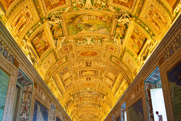 Rome, Italy - Jan 3, 2020:  Wall and ceiling paintings in the Gallery of Maps  at the Vatican Museum, Vatican City, Rome.