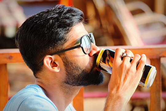 Close-Up Of Man Drinking From Can