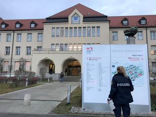 A police officer looks at a clinic map of the Klinikum Schwabing in Munich