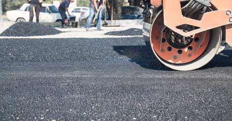 Asphalt roller. Industry. Work. New road