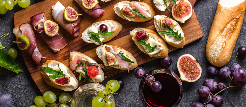Mediterranean snack for wine. Traditional tapas bar, spanish table with food, platter with appetizer or italian bruschetta.