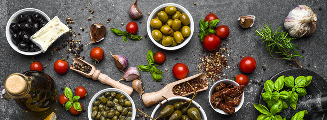 Mediterranean food background with herbs, olive, oil, tomatoes, basil