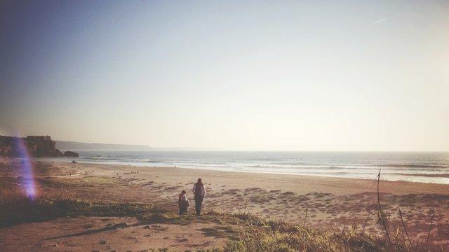 Family Walking At Beach