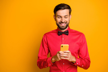 Photo of attractive business guy hold telephone social network worker writing advertisement...