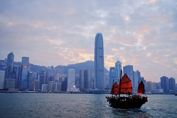 Poster White Traditional wooden sailboat sailing in Victoria harbor, Hong Kong.