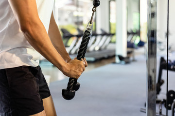 A man training triceps in the gym