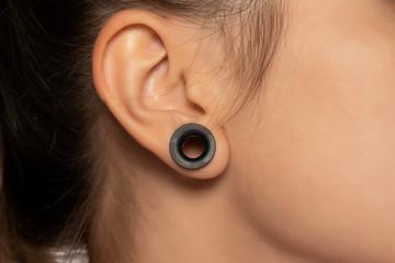 Female tunnel ear hole earring pierce