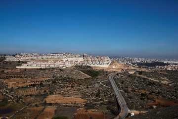 A general view picture shows the Israeli settlement of Efrat in the Gush Etzion settlement block as Bethlehem is seen in the background, in the Israeli-occupied West Bank