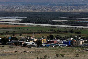 A view shows the Palestinian village of Fasayil as Israeli farms appear in the background, near Jericho in the Israeli-occupied West Bank