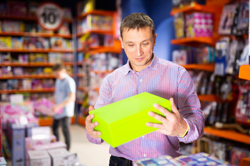 Man shopping in store of kids toys
