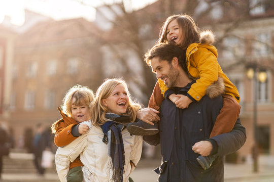 Affectionate young family enjoying their day in a city