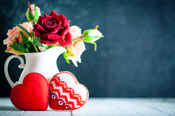 Greeting card with flowers and heart. Background with copy space. Selective focus.