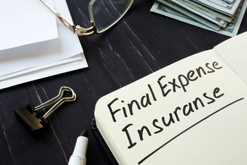 Final expense insurance memo in the black notepad.