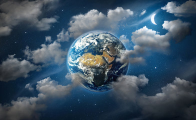 Wall Mural - Planet Earth surrounded by clouds, the moon and stars in the night sky. Fantasy  collage on travel, geography, space, science and education topics. Elements of this image furnished by NASA.