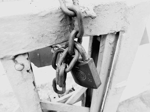 Close-Up Of Padlocks Hanging On Metallic Door
