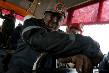 Miners are seen in a bus after work at Zasyadko coal mine in Donetsk