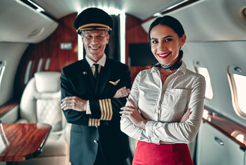 Pilot and flight attendant in private jet Wall mural