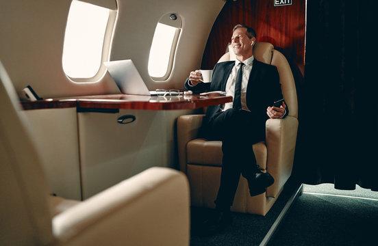 Businessman in private jet