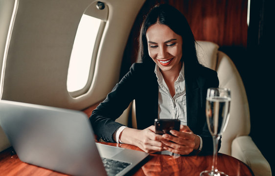 Business woman in private jet